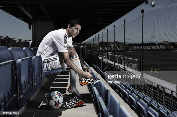 In this image from adidas Angel Di Maria of Real Madrid tries on his adidas Predator Battle Pack boots ahead of Saturday's UEFA Champions League...