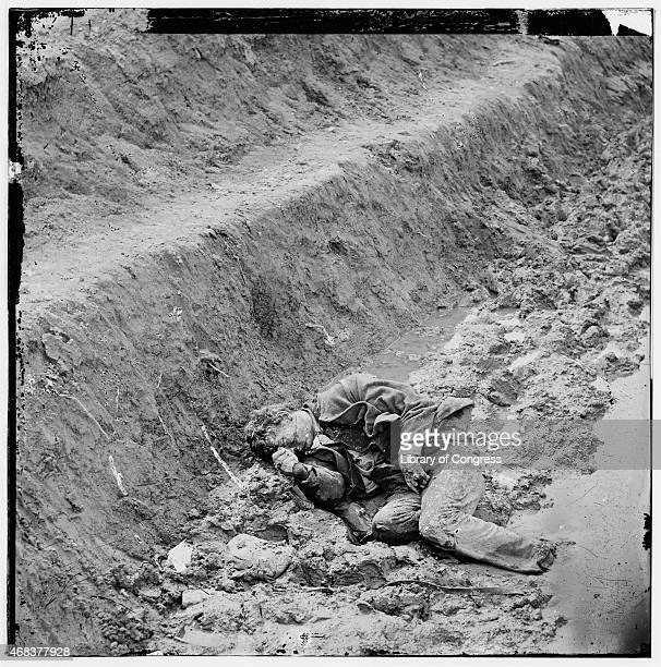In this image from the U.S. Library of Congress, a dead Confederate soldier lies in a trench of Fort Mahone April 3, 1865 in Petersburg, Virginia.