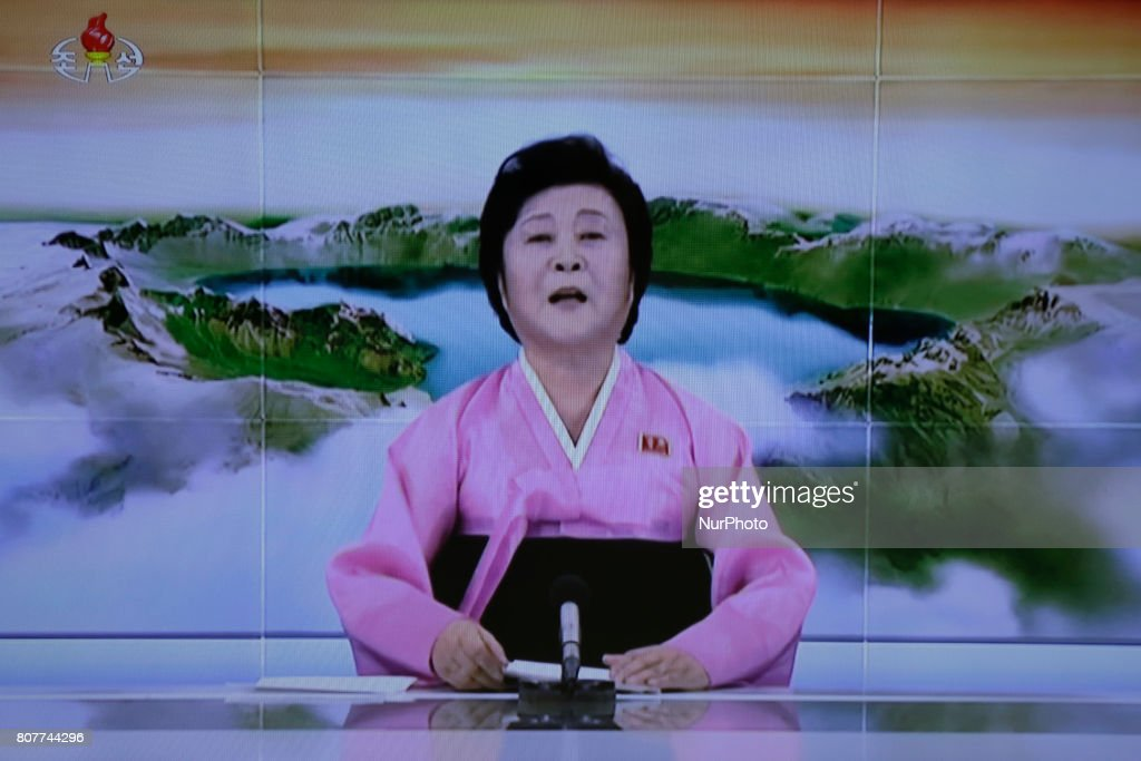In this image made from video of a news bulletin Tuesday, July 4, 2017, North Korea's KRT television shows a presenter announcing North Korea has test-launched its first intercontinental ballistic missile. This appears to contradict South Korean and U.S. officials who said Tuesday's launch was an intermediate-range missile.