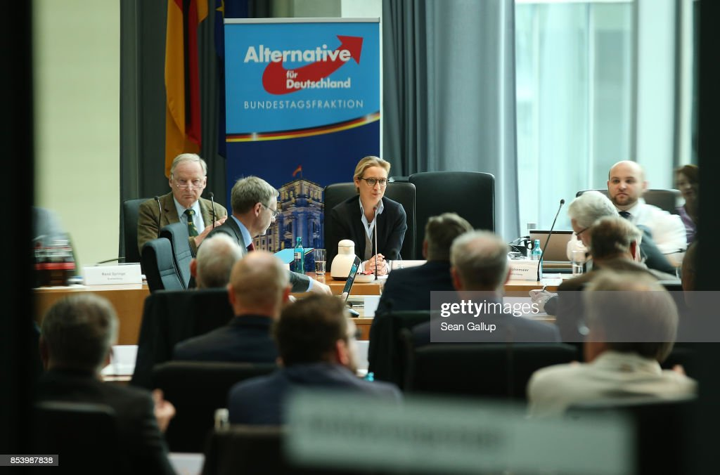In this image photographed through a glass door Alexander Gauland and Alice Weidel, who will lead the new Bundestag faction of the right-wing Alternative for Germany (AfD) faction in the Bundestag, meet with party members to create the AfD Bundestag faction on September 26, 2017 in Berlin, Germany. The AfD came in third place with 12.6%, which gives it 94 seats in the Bundestag, the German parliament. One seat will however go to Frauke Petry, a leading AfD member from Saxony who in a surprise move announced yesterday that she will not join the AfD faction and instead serve as an independent.