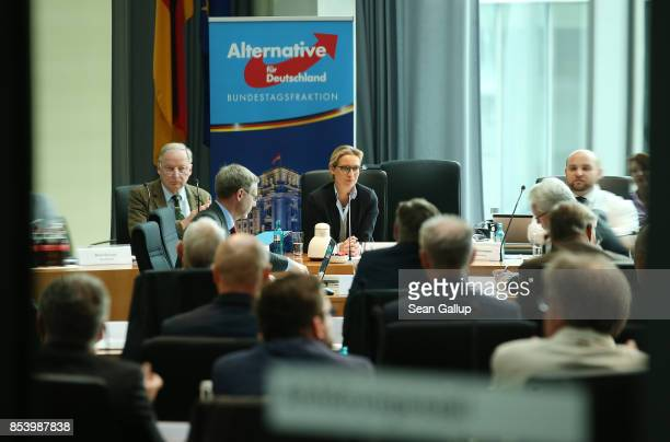 In this image photographed through a glass door Alexander Gauland and Alice Weidel who will lead the new Bundestag faction of the rightwing...
