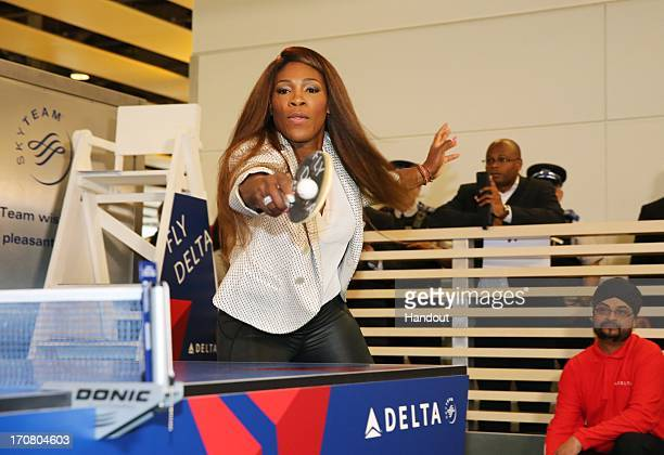 In this image provided by Delta Air Lines, Serena Williams challenges Delta travellers to an impromptu game of table tennis at Heathrow Airport on...