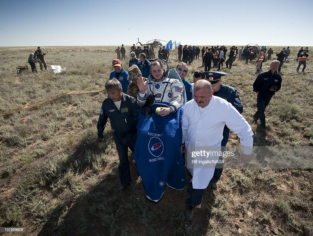 In this image provided by NASA, Expedition 23 Flight Engineer T.J. Creamer sits in a chair outside the Soyuz Capsule just minutes after he and fellow crew members Soichi Noguchi and T.J. Creamer landed in their Soyuz TMA-17 capsule on June 2, 2010 near the town of Zhezkazgan, Kazakhstan. NASA Astronaut Creamer, Russian Cosmonaut Kotov and Japanese Astronaut Noguchi are returning from six months onboard the International Space Station where they served as members of the Expedition 22 and 23 crews.