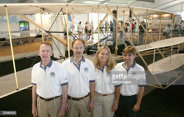 In this image provided by the Experimental Aircraft Association , pilots Ken Hyde, Kevin Kochersberger, Terry Queijo and Chris Johnson stand near a...