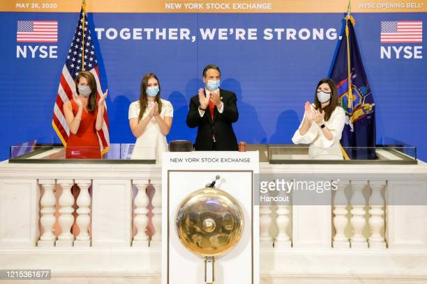 In this image provided by the New York Stock Exchange , Gov. Andrew Cuomo rings the opening bell to mark the reopening of the trading floor with NYSE...