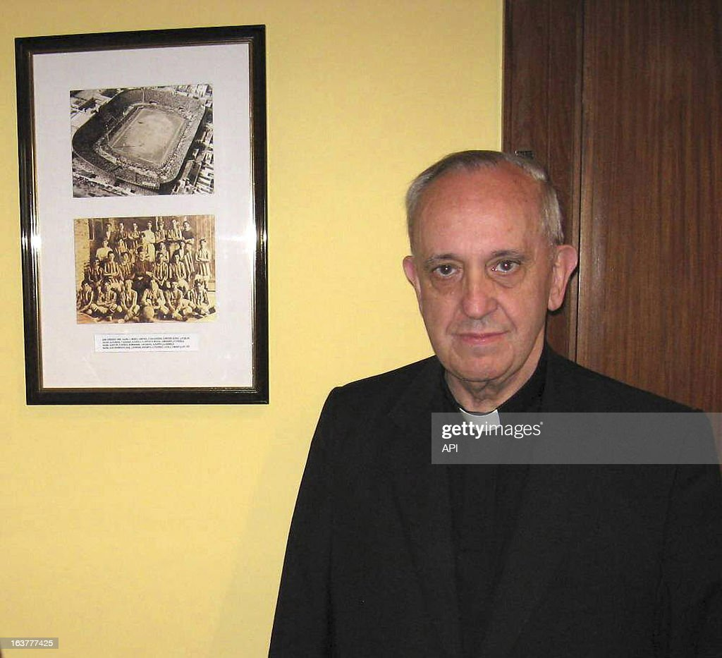 In this image provided by the San Lorenzo Futbol Club, Jorge Mario Bergoglio, poses at the club, in Buenos Aires, Argentina.