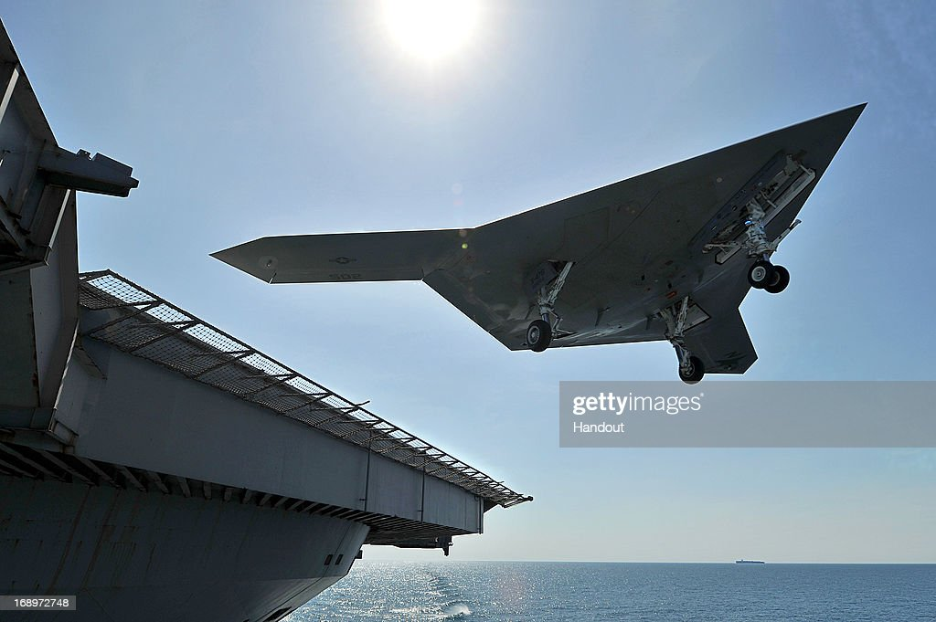 In this image provided by the U.S. Navy, an X-47B unmanned combat air system (UCAS) demonstrator performs a touch and go landing May 17, 2013 on the flight deck of the aircraft carrier USS George H.W. Bush (CVN 77) in the Atlantic Ocean. This is the first time any unmanned aircraft has completed a touch and go landing at sea. George H.W. Bush is conducting training operations in the Atlantic Ocean.