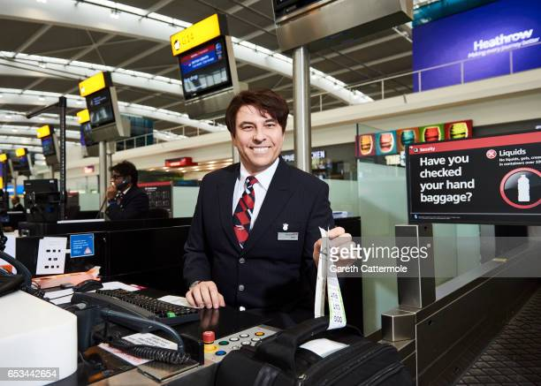 In this image released by British Airways today March 15th 2017 in London England David Walliams checksin British Airways passengers at Heathrow T5...