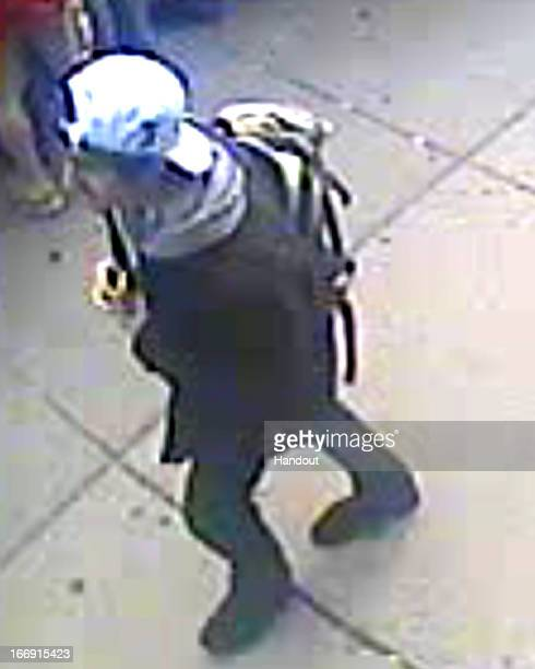 In this image released by the Federal Bureau of Investigation on April 18 a suspect in the Boston Marathon bombing walks near the marathon finish...