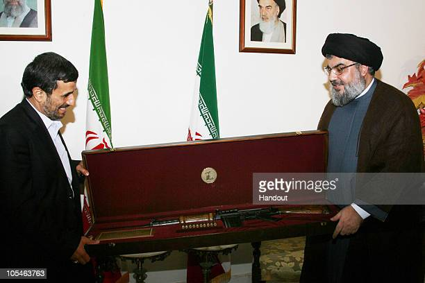 In this image released by the Hezbollah Media Office, Hezbollah Secretary General Sayyed Hassan Nasrallah , presents Iranian President Mahmoud...