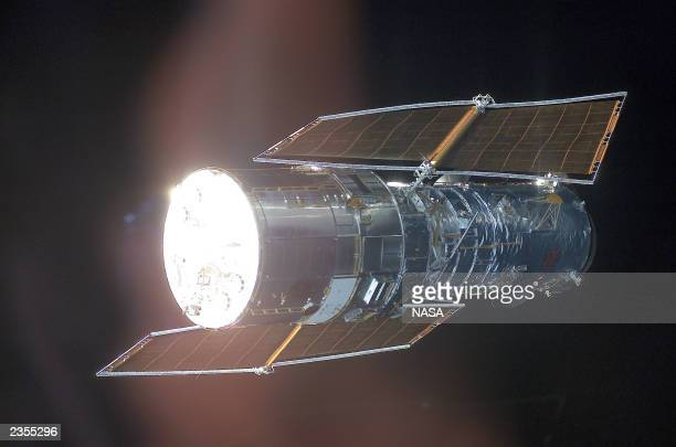 In this image released by the National Aeronautics and Space Administration , the Hubble Space Telescope is backdropped against black space as the...