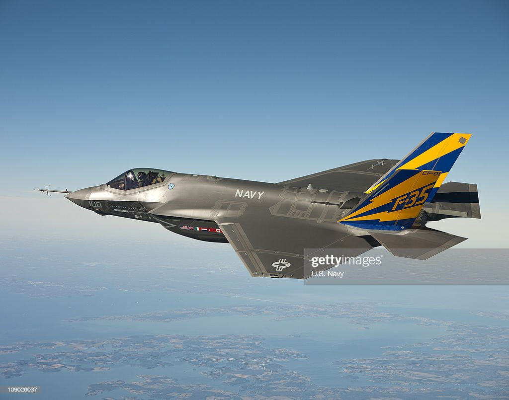 In this image released by the U.S. Navy courtesy of Lockheed Martin, the U.S. Navy variant of the F-35 Joint Strike Fighter, the F-35C, conducts a test flight February 11, 2011 over the Chesapeake Bay. Lt. Cmdr. Eric 'Magic' Buus flew the F-35C for two hours, checking instruments that will measure structural loads on the airframe during flight maneuvers. The F-35C is distinct from the F-35A and F-35B variants with larger wing surfaces and reinforced landing gear for greater control when operating in the demanding carrier take-off and landing environment.