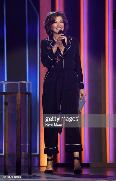 In this image released on April 18, Amy Grant speaks onstage at the 56th Academy of Country Music Awards at the Grand Ole Opry on April 18, 2021 in...