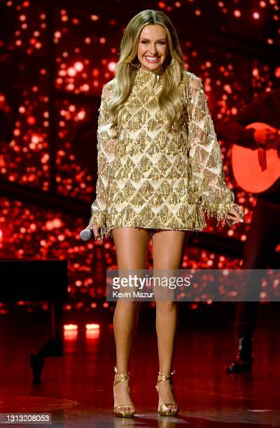 In this image released on April 18, Carly Pearce performs onstage at the 56th Academy of Country Music Awards at the Grand Ole Opry on April 18, 2021...