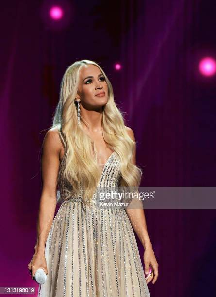 In this image released on April 18, Carrie Underwood performs onstage at the 56th Academy of Country Music Awards at the Grand Ole Opry on April 18,...