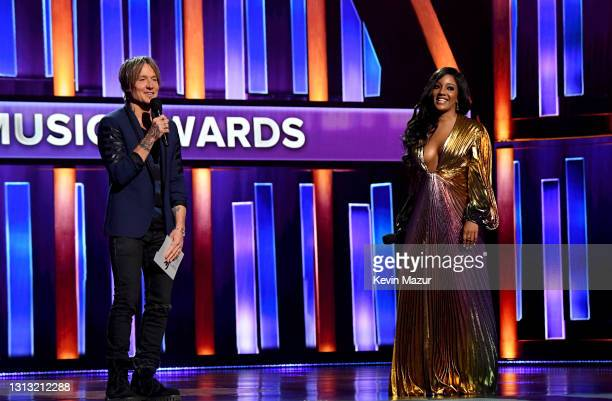 In this image released on April 18, co-hosts Keith Urban and Mickey Guyton speak onstage at the 56th Academy of Country Music Awards at the Grand Ole...