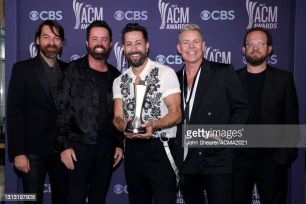 In this image released on April 18, Geoff Sprung, Brad Tursi, Matthew Ramsey, Trevor Rosen, and Whit Sellers of Old Dominion, winner of the award for...