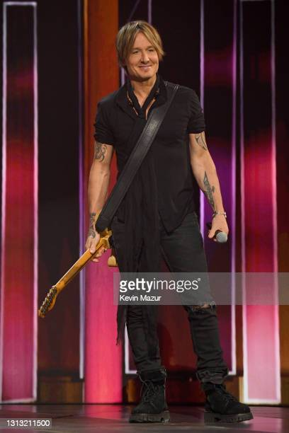 In this image released on April 18, Keith Urban performs onstage at the 56th Academy of Country Music Awards at the Grand Ole Opry on April 18, 2021...