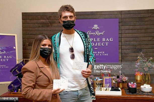 In this image released on April 18, Maren Morris and Ryan Hurd are seen at Crown Royal Purple Bag Project packing a bag to be sent to a military hero...