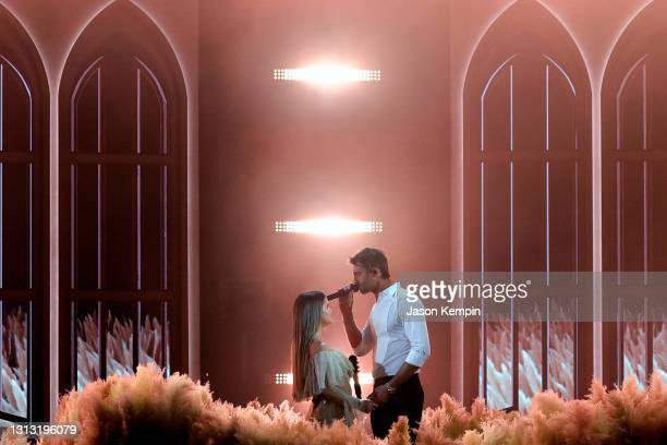 In this image released on April 18, Maren Morris and Ryan Hurd perform onstage at the 56th Academy of Country Music Awards at the Ryman Auditorium on...