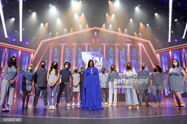 In this image released on April 18, Mickey Guyton poses with a youth choir onstage at the 56th Academy of Country Music Awards at the Grand Ole Opry...