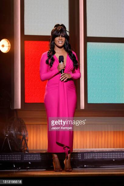 In this image released on April 18, Mickey Guyton speaks onstage at the 56th Academy of Country Music Awards at the Ryman Auditorium on April 18,...