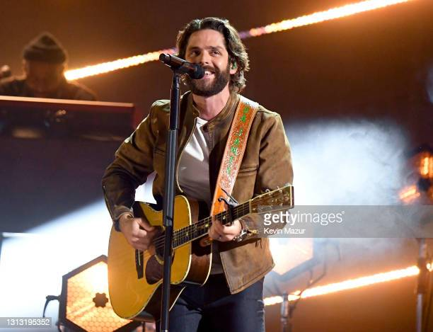 In this image released on April 18, Thomas Rhett performs onstage at the 56th Academy of Country Music Awards at the Grand Ole Opry on April 18, 2021...