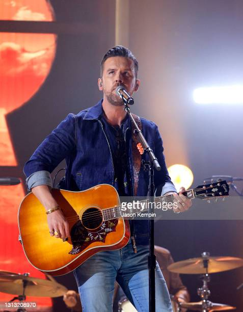 In this image released on April 18, T.J. Osborne of Brothers Osborne performs onstage at the 56th Academy of Country Music Awards at the Ryman...
