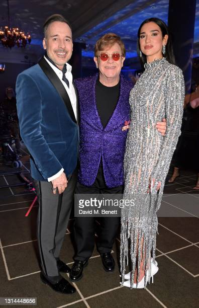 In this image released on April 25, David Furnish, Sir Elton John and Dua Lipa attend the 29th Annual Elton John AIDS Foundation Academy Awards...