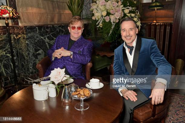 In this image released on April 25, Sir Elton John and David Furnish attend the 29th Annual Elton John AIDS Foundation Academy Awards Viewing Party...