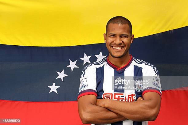 In this image released on August 10 Jose Salomon Rondon poses with the flag of Venezuela as he is unveiled by West Bromwich Albion at West Bromwich...