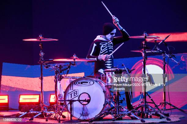 In this image released on December 6, Travis Barker performs at the 2020 MTV Movie & TV Awards: Greatest Of All Time broadcast on December 6, 2020.