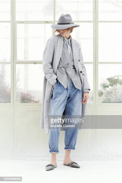 In this image released on February the 24th, a model poses at the Brunello Cucinelli Fashion Show during the Milan Fashion Week Fall/Winter 2021/2022...