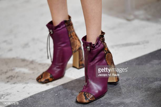 In this image released on February the 24th, a model, shoes detail, poses in the backstage at the Maryling Fashion Show during the Milan Fashion Week...
