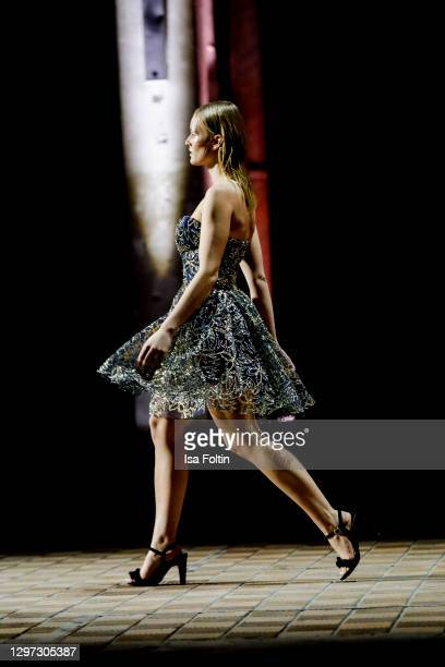 In this image released on January 19, a model walks the runway at the Lana Mueller show during the Mercedes-Benz Fashion Week Berlin January 2021 at...