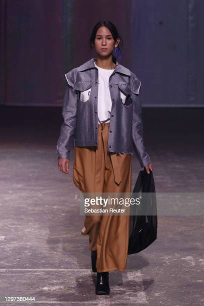 In this image released on January 20, a model poses wearing a design by People at the Fashion Open Studio: Designer Showcase during the Mercedes-Benz...