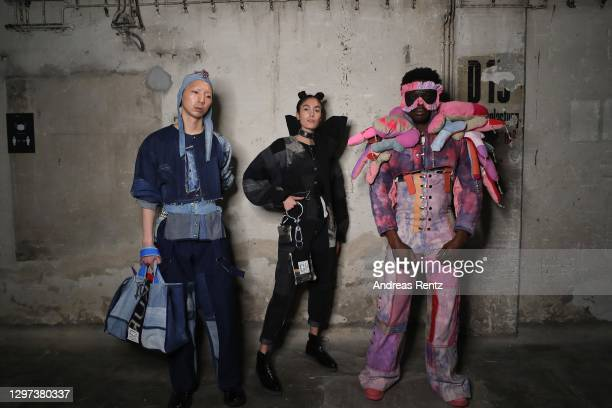 In this image released on January 20, models pose wearing designs by Fade Out Label poses backstage ahead of the Fashion Open Studio: Designer...