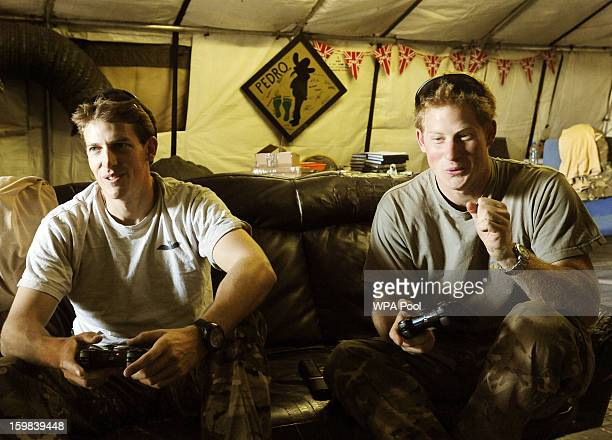 In this image released on January 21 Prince Harry celebrates as he scores a goal during a computer football game with his fellow Apache Helicopter...