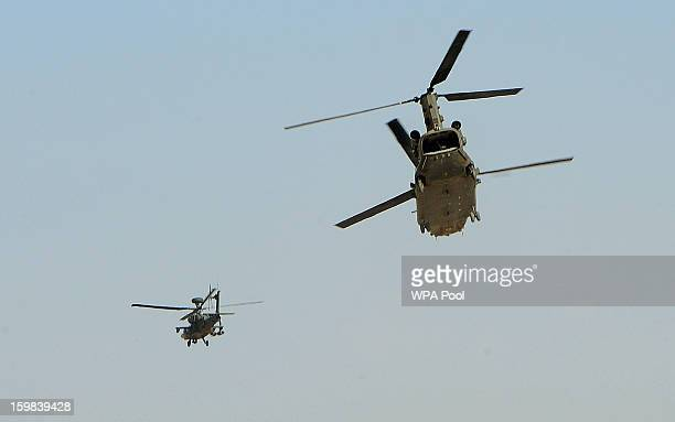 In this image released on January 21 Prince Harry flies an Apache helicopter as protection for a Chinook Helicopter above the British controlled...