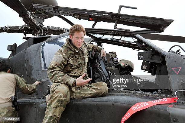 In this image released on January 21 Prince Harry makes early morning checks as he sits on an Apache helicopter at the British controlled flightline...