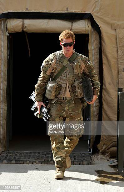 In this image released on January 21 Prince Harry walks through the British controlled flightline in Camp Bastion on October 31 2012 in Afghanistan...