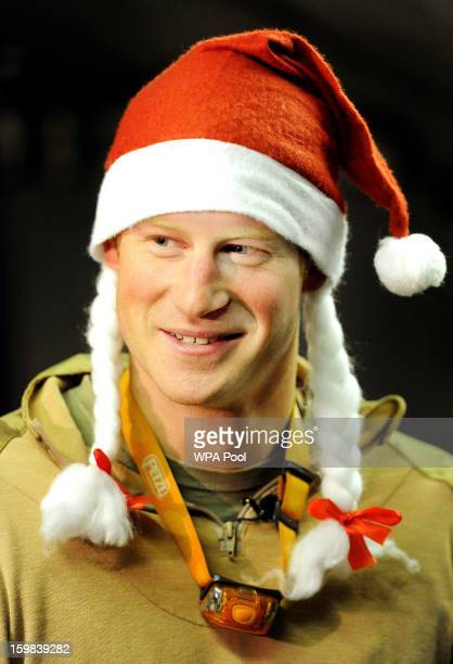In this image released on January 21 Prince Harry wears a Santa hat at the VHR tent close to the flightline at the British controlled flightline at...