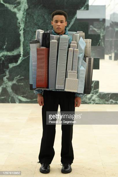 In this image released on January 21st, a model walks the runway during the Louis Vuitton Menswear Fall/Winter 2021-2022 show as part of Paris...