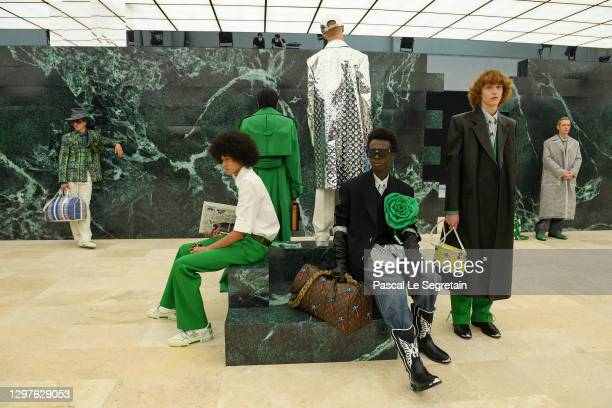 In this image released on January 21st, models walk the runway during the Louis Vuitton Menswear Fall/Winter 2021-2022 show as part of Paris Fashion...