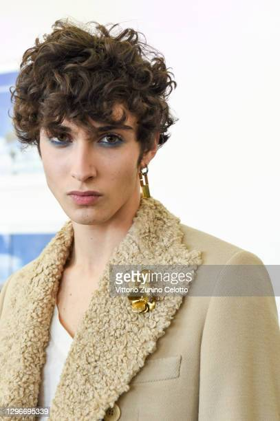 In this image released on January the 16th, a model is seen in the backstage at the Miguel Vieira Fashion Show during the Milan Men's Fashion Week...