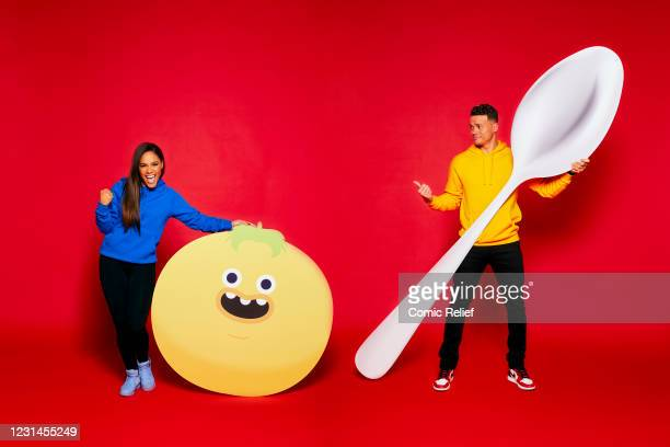 In this image released on March 1 The One Show's Alex Scott and Jermaine Jenas pose during a portrait session for the ultimate Red Nose and Spoon...