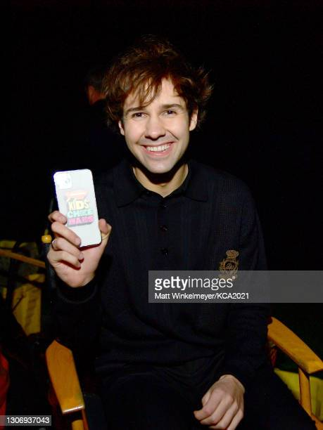 In this image released on March 13, David Dobrik attends Nickelodeon's Kids' Choice Awards at Barker Hangar on March 13, 2021 in Santa Monica,...