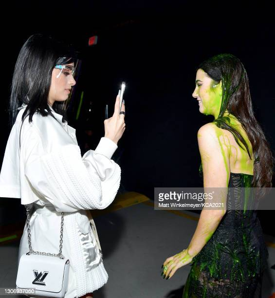 In this image released on March 13, Dixie D'Amelio and Charli D'Amelio attend Nickelodeon's Kids' Choice Awards at Barker Hangar on March 13, 2021 in...