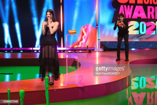 In this image released on March 13, Favorite Female Social Star Charli D'Amelio and David Dobrik speak onstage during Nickelodeon's Kids' Choice...