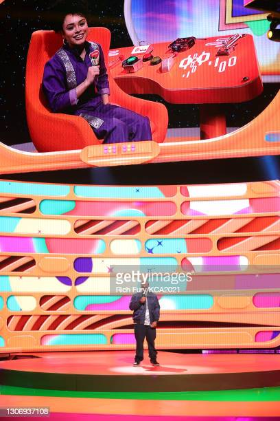 In this image released on March 13, Gabrielle Nevaeh Green and host Kenan Thompson speak onstage during Nickelodeon's Kids' Choice Awards at Barker...